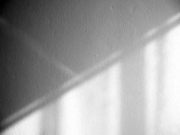white black wall light shadow texture background - тень стоковые фото и изображения