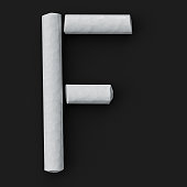 White blackboard chalks assembled capital letter F on rough blackboard, 3D rendered font image