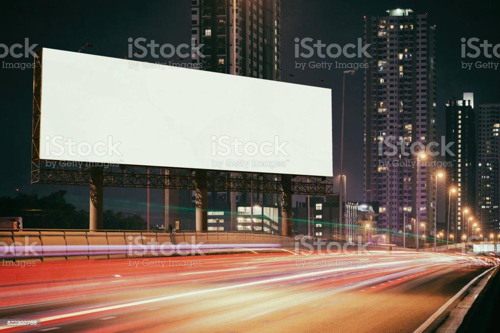 White Blank billboard on light trails night street, city stock photo