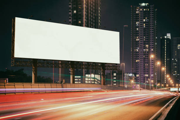 White Blank billboard on light trails night street, city White Blank billboard on light trails, street, city and urban in the dusk or night in classic style - can advertisement for display or montage product or business. billboard stock pictures, royalty-free photos & images