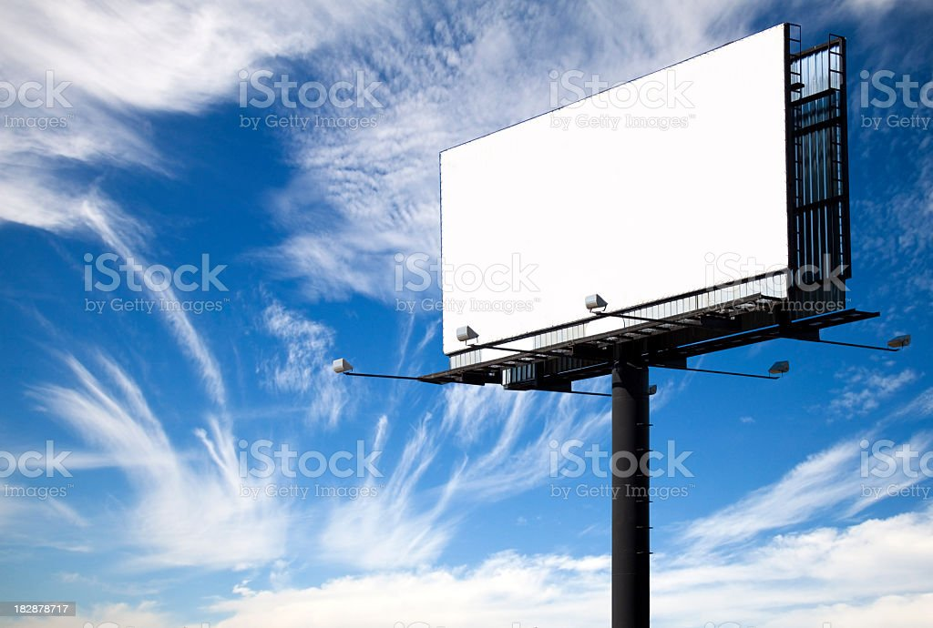 A white blank billboard with the view of the sky stock photo