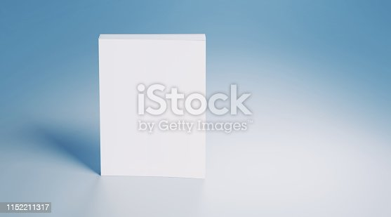 White blank book on blue background. Horizontal composition with copy space.