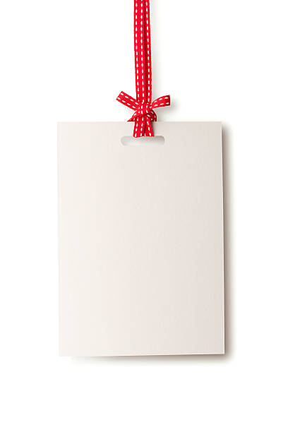 white blank card hanging from red ribbon - label stock pictures, royalty-free photos & images
