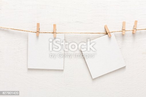 istock White blank cards on rope, copy space 827901420