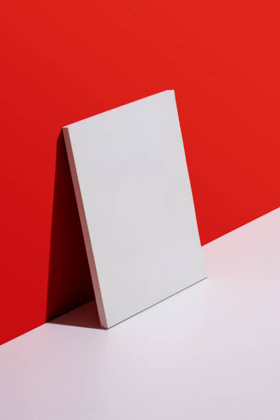 White blank cover magazine over red and white background stock photo