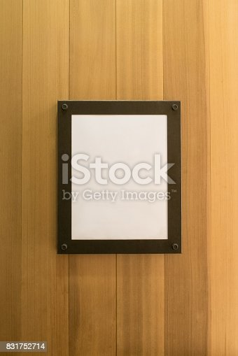 532332971 istock photo white blank empty brown photo Frame on wooden wall. Background, Wallpaper 831752714