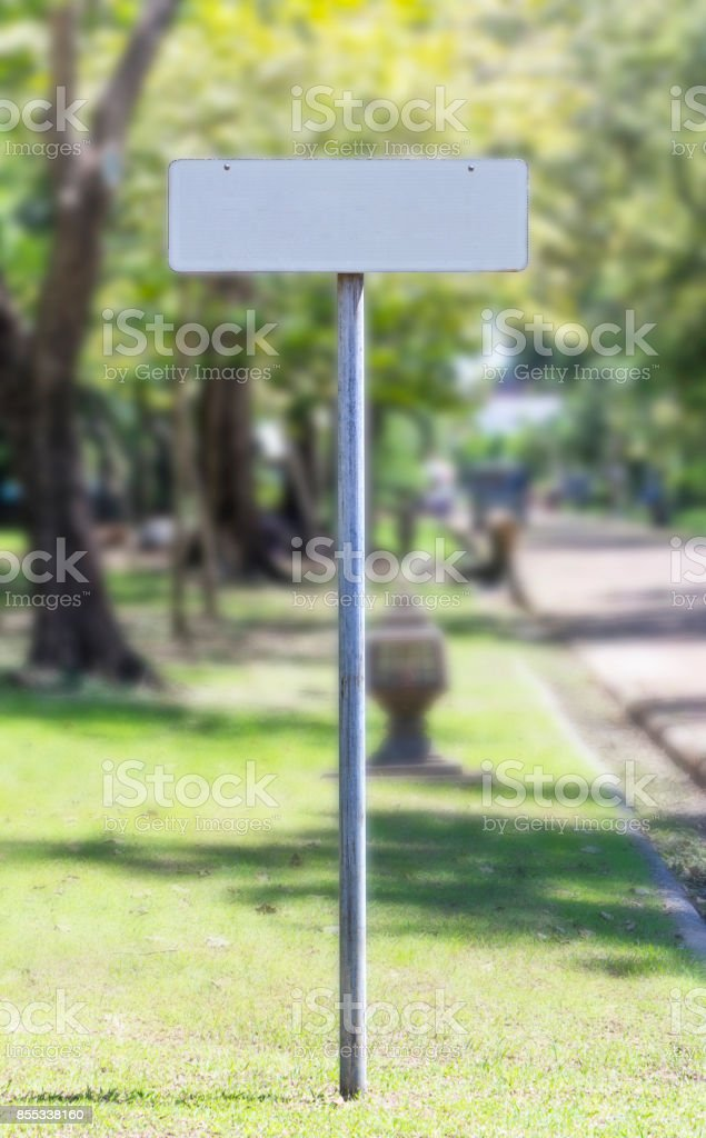 white blank guidepost made of metal in the garden. stock photo