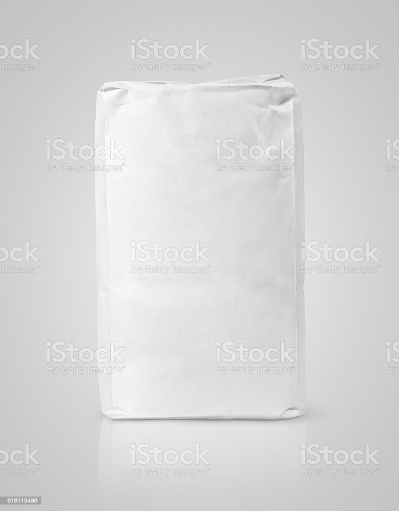 White blank paper bag package of flour on gray stock photo