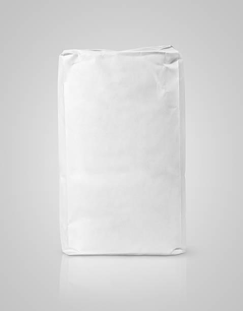 white blank paper bag package of flour on gray - zak tas stockfoto's en -beelden