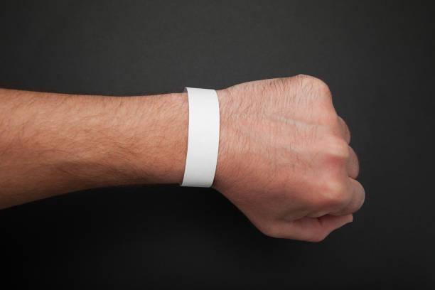 white blank paper wristband, bracelet mockup - браслет стоковые фото и изображения