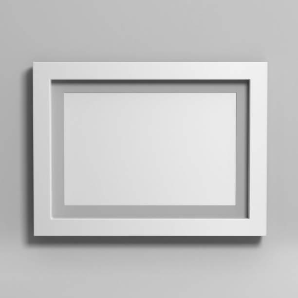 Cadre photo blanc blanc sur fond gris. - Photo