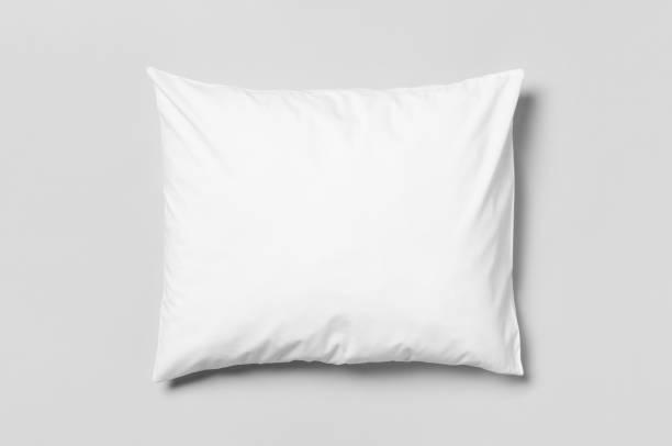 white blank pillowcase mockup. grey background. - подушка стоковые фото и изображения
