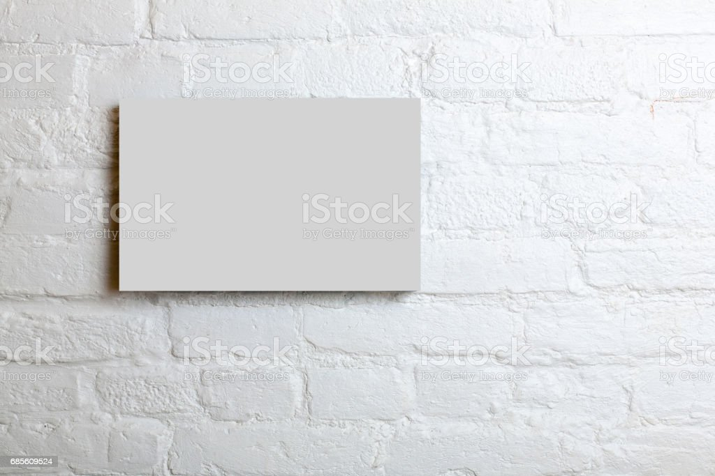 White blank poster in a white brick wall. Template Mock up for your content royalty-free 스톡 사진