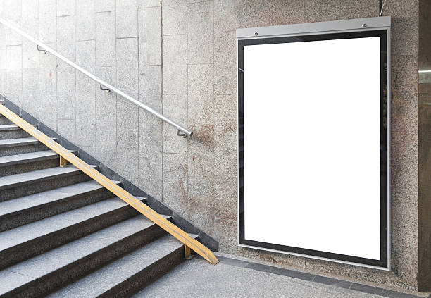 White blank poster with wood borders on the wall stock photo