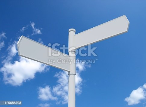 istock White blank signpost isolated on blue sky. 1129688793