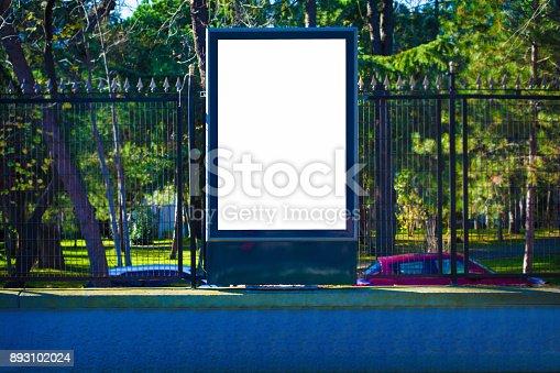 istock white blank street advertising billboard on wall 893102024