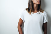 istock white blank t-shirt, woman model close-up 948336752
