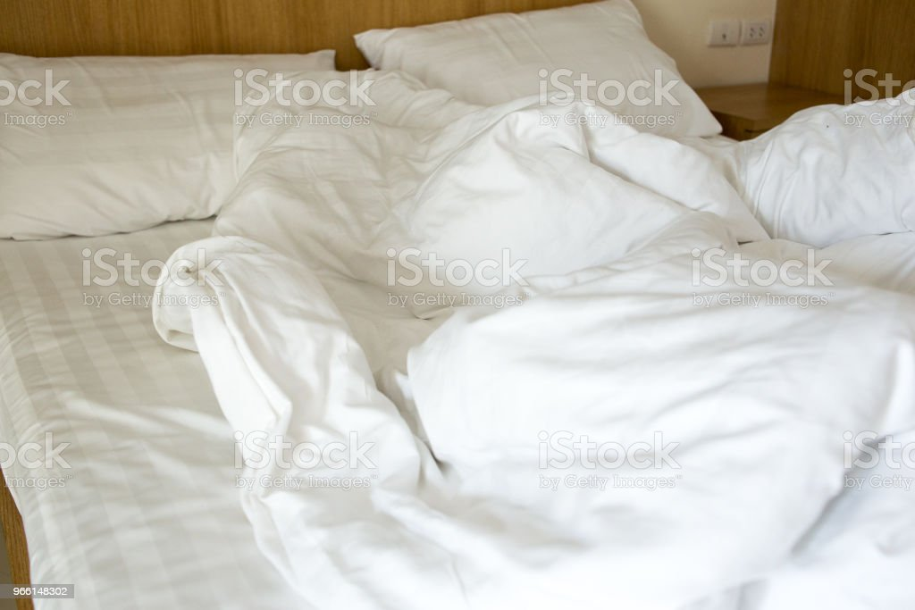white blanket dishevelled on the bed - Royalty-free Bed - Furniture Stock Photo