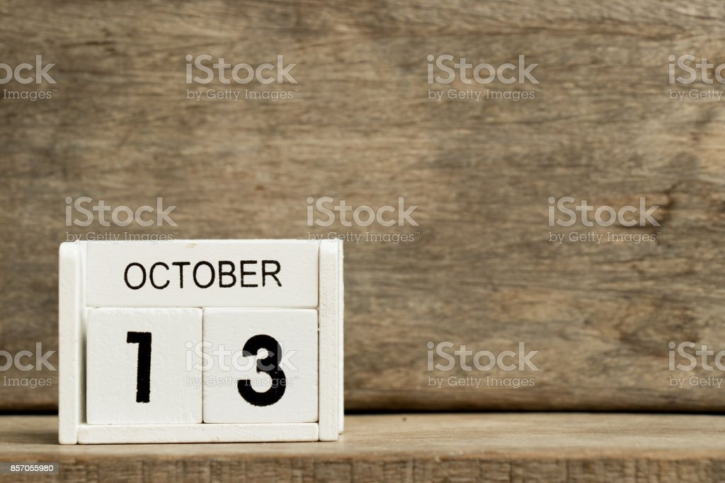 White block calendar present date 13 and month October on wood background stock photo