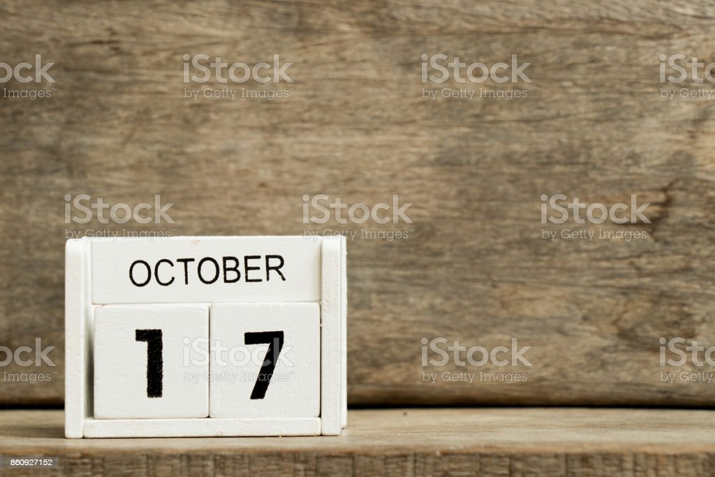 White block calendar present date 17 and month October on wood background stock photo