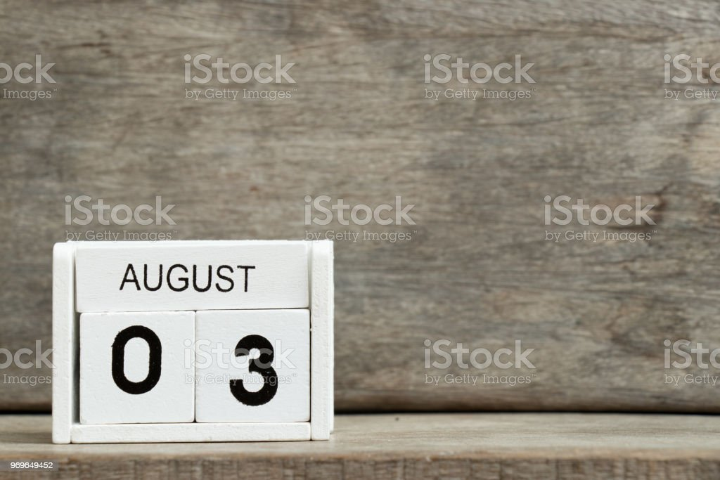 White block calendar present date 3 and month August on wood background stock photo