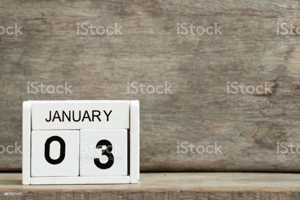 White block calendar present date 3 and month January on wood background stock photo