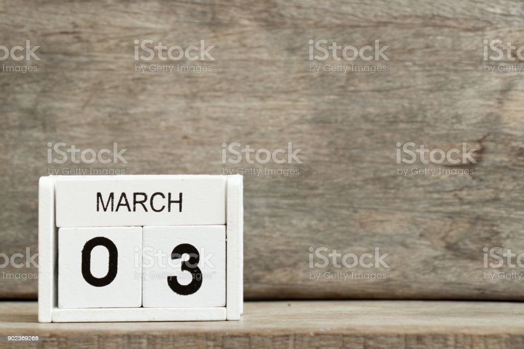 White block calendar present date 3 and month March on wood background stock photo