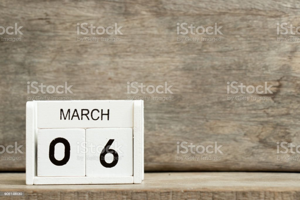 White block calendar present date 6 and month March on wood background stock photo