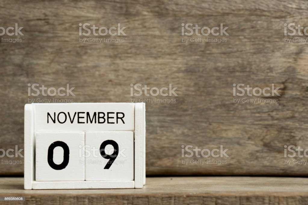 White block calendar present date 9 and month November on wood background stock photo