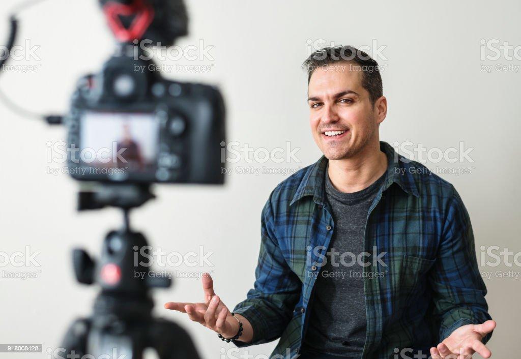 White blogger recording video stock photo