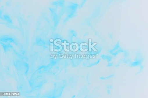 istock White blue abstract background on liquid, blue minimalistic background, blue pattern, light texture for designer, background preparation, stains on milk 905308850