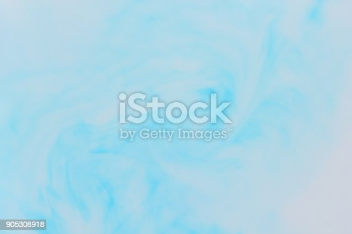 istock White blue abstract background on liquid, blue minimalistic background, blue pattern, light texture for designer, background preparation, stains on milk 905308918