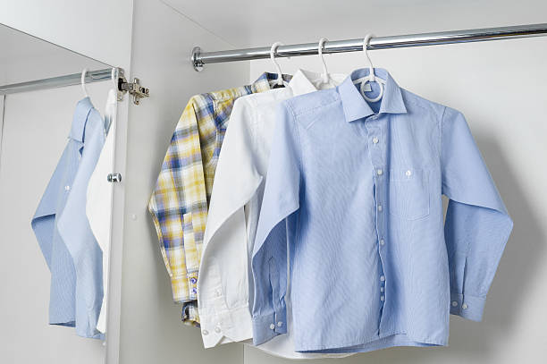 white blue and checkered clean ironed men shirts stock photo
