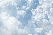 White & blue soft cumulus clouds in the sky close up background, big fluffy cloud texture, beautiful cloudscape skies backdrop, sunny cloudy heaven pattern, cloudiness weather landscape, copy space