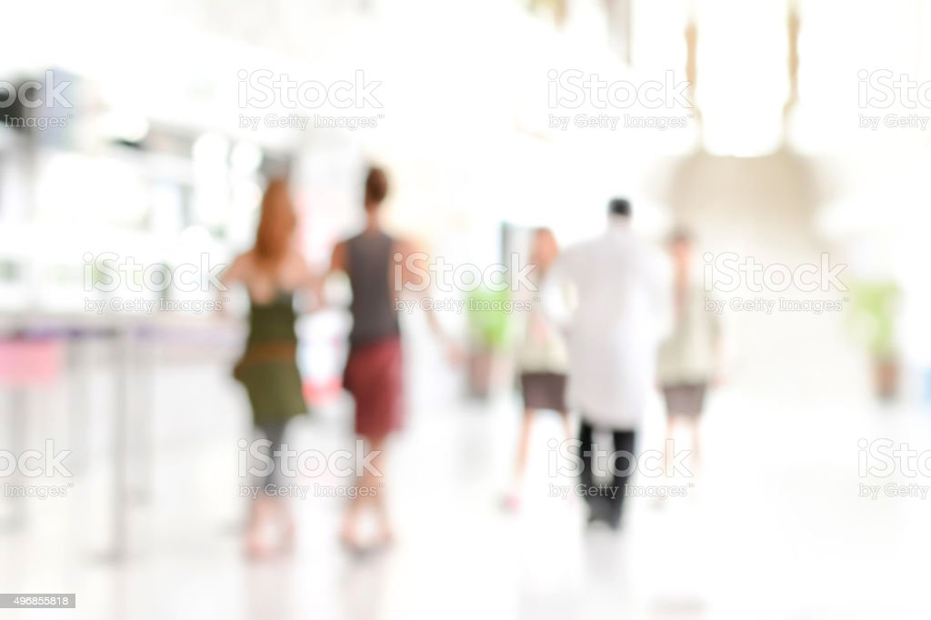 White Blur Abstract Background Of People Walking In Hospital Hallway Royalty Free Stock Photo