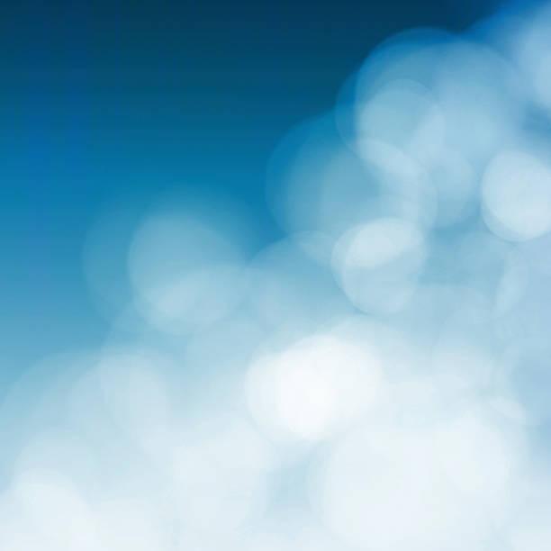 white blurs on blue background - onschuld stockfoto's en -beelden