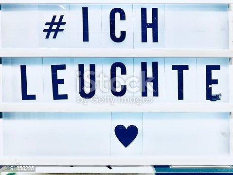 White Board with hashtag: german text, i shine, ich leuchte