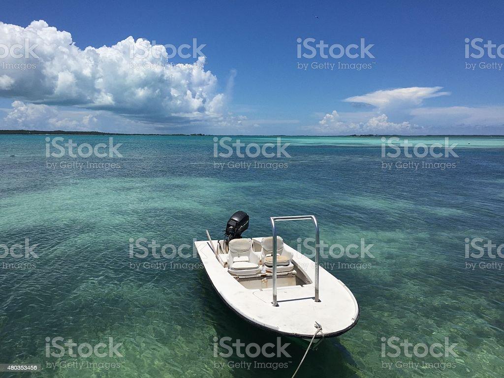 White Boat in Harbor Island Bahamas stock photo
