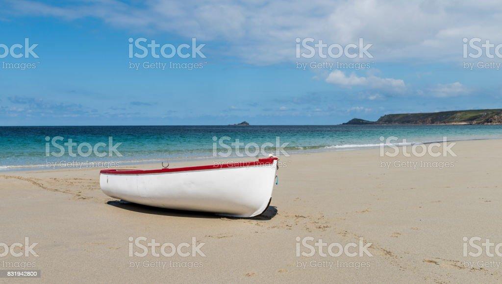 White Boat on Beach stock photo