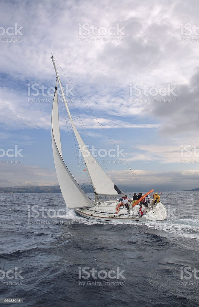 A white boat sailing on the black sea royalty-free stock photo