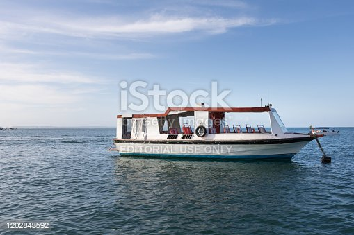Bahia, Brazil - January 2020: Yacht passenger boat in the middle of the ocean. Morro de Sao Paulo, Salvador, Brazil. Hill.