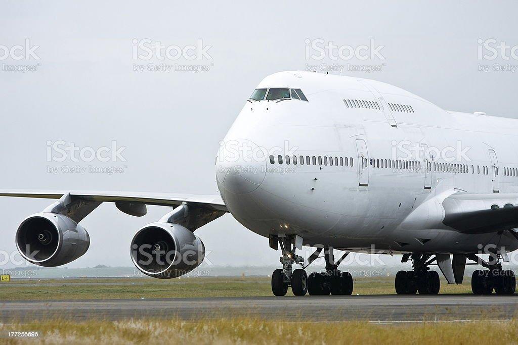 White Boeing 747 jumbo jet on the runway stock photo
