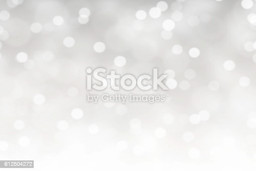 istock White Bokeh Lights Abstract Background 612504272