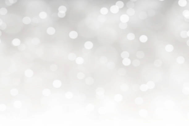 white bokeh lights abstract background - flocon de neige neige photos et images de collection