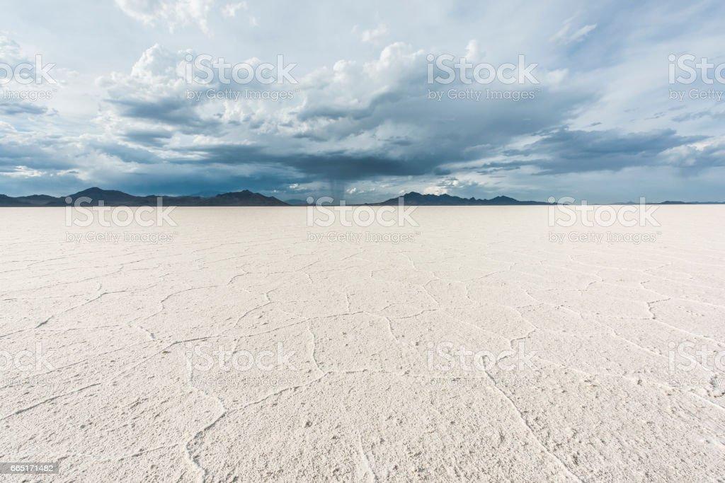 White Bonneville Salt Flats landscape with rain storm clouds in distance stock photo