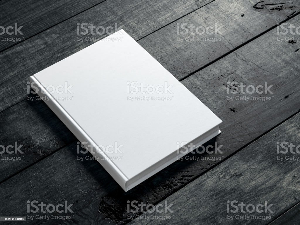 White book Mockup on dark wooden table background royalty-free stock photo