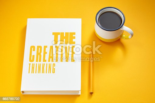 istock white book on the yellow background 665785702