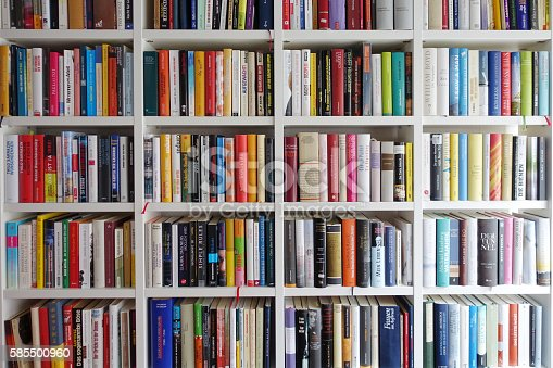 White book shelves narrowly packed with german books stock for The craft of research audiobook