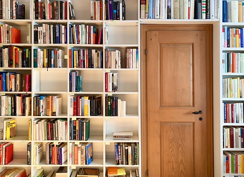 White book shelves with empty parts