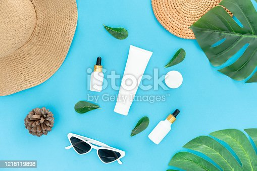 istock White bottle cream, mockup of beauty product brand. Top view on the blue background. 1218119898